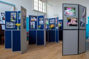 Exhibition boards in use, at a photographic exhibition