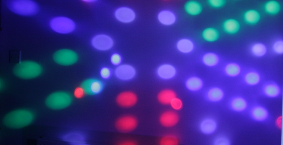 Pattern of coloured patches of light, created by disco lights.