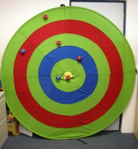 Multi-target: pop-up fabric target, standing against a wall, with velcro balls attached.
